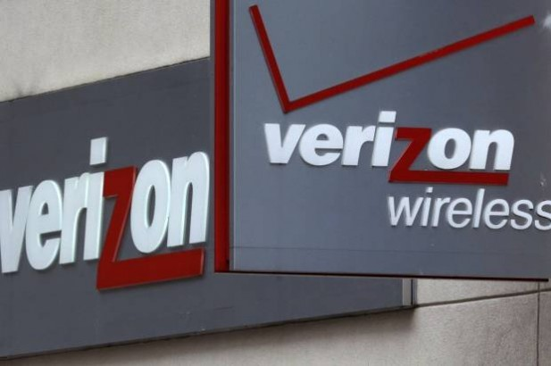 This June 4, 2014 photo shows signage at a Verizon Wireless retail store at Downtown Crossing in Boston.(Credit: AP/Charles Krupa)