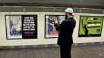 Cyrus McGoldrick, takes a photo with his cell phone of an anti-Muslim poster in New York's Times Square subway station. Thirty-three key organizations promoting anti-Muslim sentiment had access to a combined budget of $205,838,077 between 2008 and 2013 alone.