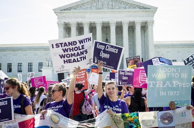 Pro-choice and pro-life activists demonstrate on the steps of the United States Supreme Court. Credit: Getty Images