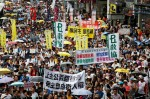 BOBBY YIP / REUTERS Pro-democracy protesters take part in a march on the day marking the 19th anniversary of Hong Kong's handover to Chinese sovereignty from British rule, in Hong Kong July 1, 2016.