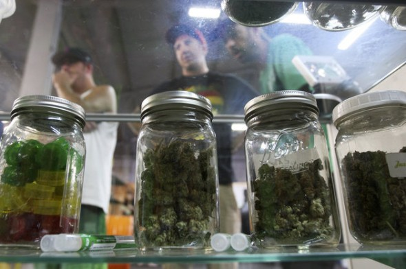 DAVID MCNEW / REUTERS Jars containing marijuana are seen at a medical marijuana farmers market at the California Heritage Market in Los Angeles.