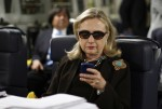Hillary Clinton checking her Blackberry in 2011, when she was the secretary of state. (Kevin Lamarque / AP)