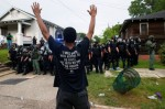 A demonstrator raises his hands in front of police in riot gear during protests in Baton Rouge, Louisiana, US, July 10, 2016. — Reuters - See more at: http://www.themalaymailonline.com/world/article/demonstrations-flare-in-cities-across-the-us-video#sthash.Gcan1PQ1.dpuf