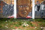 "MARK MAKELA VIA GETTY IMAGES A mural in Baltimore depicts Freddie Gray, who died in custody of Baltimore Police officers following a ""rough ride"" in a police van."