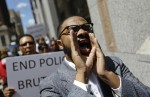 DAVID GOLDMAN/AP Melech Thomas chants during a demonstration outside the State Attorney's office calling for the investigation into the death of Freddie Gray on April 29, 2015, in Baltimore.