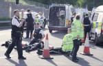 Police surround protesters blocking the road to Heathrow Airport. (Screen shot via Novara Media)