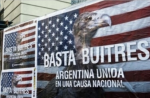 """A poster along the streets of Buenos Aires, Argentina, reads """"Enough Vultures. Argentina united in a national cause.""""   Photo: Reuters"""