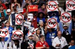 A protest against the Trans-Pacific Partnership on the first day of the 2016 Democratic National Convention in Philadelphia. (AP Photo / J. Scott Applewhite)