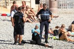 Christian Estrosi, A right-wing French official, has threatened suit against anyone who publishes images such as this one, showing French Police forcing a woman to disrobe at a Nice beach.