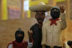 Mexican artist David Arias Dijard creates wooden action figures depicting folk heroes, such as deceased EZLN fighter Comandanta Ramona (L), Mexican 20th Century revolutionary Emiliano Zapata (C) and EZLN spokesperson Subcomandante Marcos (R). © Ryan Mallett-Outtrim