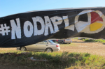 A banner protesting the Dakota Access oil pipeline is displayed at an encampment near North Dakota's Standing Rock Sioux reservation on Friday, Sept. 9, 2016. CREDIT: AP Photo/James MacPherson