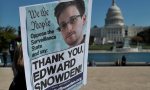 Demonstrators hold placards supporting Snowden during a 2013 protest against government surveillance in Washington DC. Photograph: Mandel Ngan/AFP/Getty Images