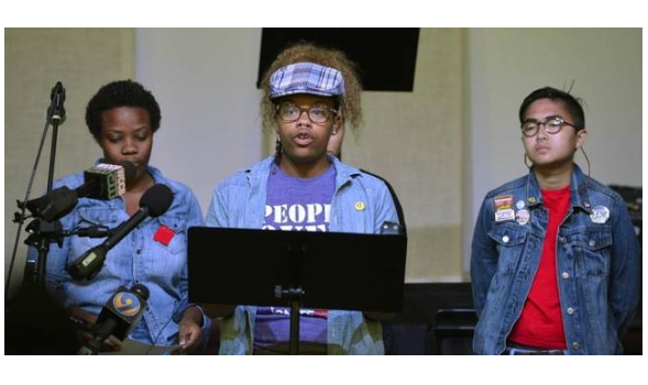 Tamika Lewis, a member of the Uprising coalition, read a list of demands in the aftermath of Keith Lamont Scott. Davie Hinshaw dhinshaw@charlotteobserver.com BY ANN DOSS HELMS