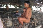 Suruwaha father and child, Brazil. Evangelical missionaries have falsely accused the tribe of infanticide on several occasions. © Adriana Huber/Survival