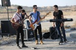The Palestinian band Dawaween performs outside of the Erez checkpoint in the Gaza Strip. The group was denied permits to enter Jerusalem in early August to perform a concert. (Photo: Mohammed Asad)