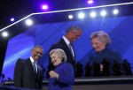 President Barack Obama is joined by presidential nominee Hillary Clinton after he spoke at the Democratic National Convention in Philadelphia in July. (Carolyn Kaster / AP)