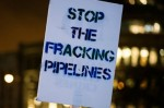 A sign held at an anti-Enbridge protest in Vancouver. (Photo: travis blanston/flickr/cc)