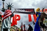 Anti-TTIP protests have brought thousands onto the streets across Europe, while the TISA talks have gone largely unnoticed Getty