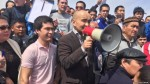 Kazakh activist Max Bokaev addressing demonstrators at a protest rally in Atyrau on April 24. (RFE/RL Kazakh Service)