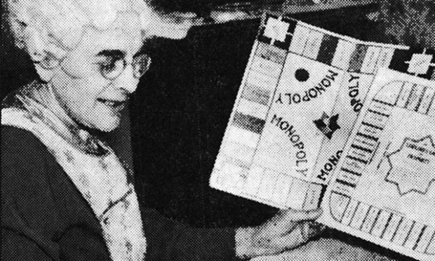 Elizabeth Magie, inventor of The Landlord's Game, holds her game next to Monopoly. (Photo: Achetron.com, via Creative Commons)