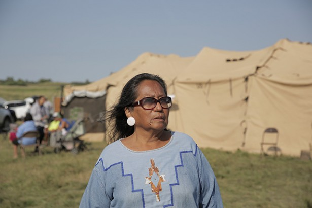 Phyllis Young, a member of the Standing Rock Sioux, speaks with reporters from a protest camp near the site of a planned road that would be used in constructing a portion of the Dakota Access oil pipeline, in Cannon Ball, North Dakota, August 18, 2016. Five hundred years after the violence of settler colonialism began in the Americas, Native peoples are still fighting to protect their lands and their rights to exist as distinct political communities and individuals. (Photo: Daniella Zalcman / The New York Times)