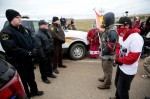 REUTERS/TERRAY SYLVESTER Dakota Access Pipeline protesters square off against police between the Standing Rock Reservation and the pipeline route outside the town of Saint Anthony, North Dakota, on Oct. 5, 2016.