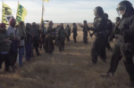 Riot police confront demonstrators over the Dakota Access Pipeline. (image: The Intercept, 10/25/16)