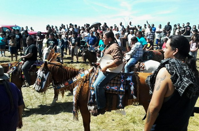 NoDAPL protest crowd including horses