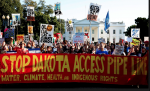 Protesters chant in opposition of the Dakota Access Pipeline on Pennsylvania Avenue in front of the White House. Photograph: Shawn Thew/EPA