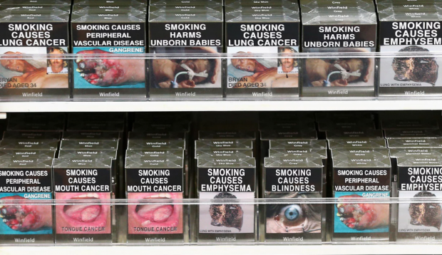 Cigarette packets with health warnings as mandated by Australia's plain-packaging laws. Photograph: Cameron Spencer/Getty Images