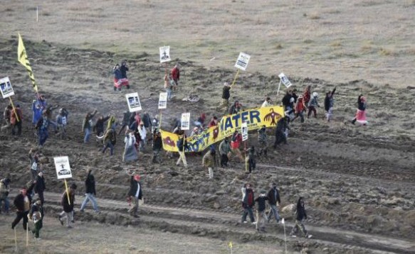 Water protectors march against the Dakota Access Pipeline on Saturday, October 22, 2016. (Photo Reuters)