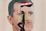 A pro-Syrian regime protester waves a Syrian flag as he stands in front of portrait of Syrian President Bashar Assad, during a protest against sanctions in Damascus, Syria on Dec. 2, 2011. Muzaffar Salman/AP