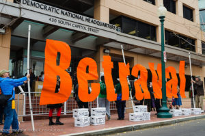 "People have been ""betrayed"" by Democrats who serve corporate interests, protesters say./Photo by Anne Meador"
