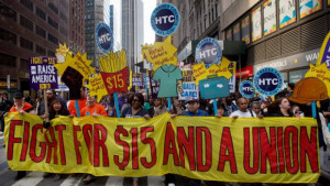 Fight for 15 Protesters hold signs at a rally in support of minimum wage increase in New York City on April 15th, 2015. By Victor J. Blue for Getty