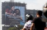 Motorists ride past a billboard displaying Facebook's Free Basics initiative in Mumbai, India, December 30, 2015. DANISH SIDDIQUI/REUTERS