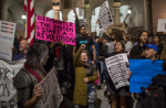People protest against the appointment of former Breitbart News head Stephen Bannon to be chief strategist of the White House by President-elect Donald Trump near City Hall in Los Angeles. Photograph: David Mcnew/AFP/Getty Images