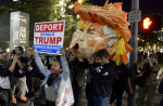 Protesters carry an effigy of Donald Trump in Los Angeles.