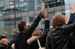 Staff of French news channel iTele vote to renew their strike for another day on November 7, 2016 in front of the channel's headquarters in Boulogne-Billancourt/AF