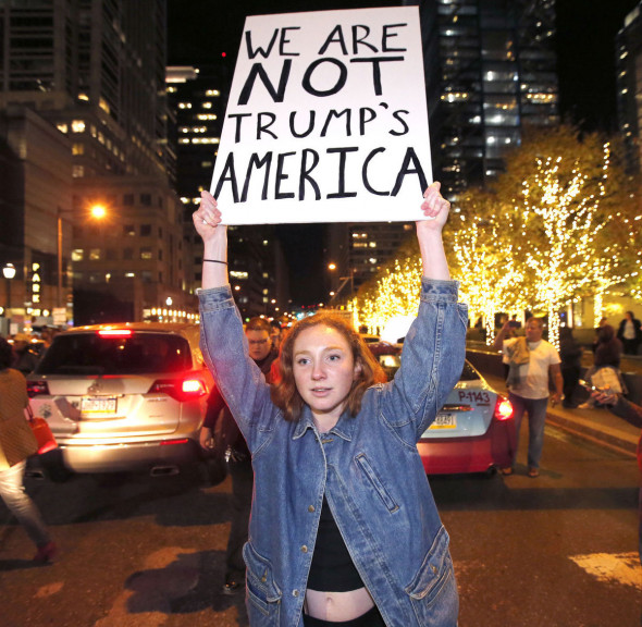 A protesters unhappy with the presidential election blocks traffic on JFK Blvd. as they march between cars on Thursday, Nov. 10, 2016, in Philadelphia. (Charles Fox/The Philadelphia Inquirer via AP)