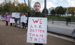 People outside the White House protest against President-elect Donald Trump's election. Photograph by Michael Reynolds-EPA