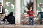 LEAD ZONE: St. Joseph, Missouri, has neighborhoods filled with aged homes and high rates of lead poisoning. Here, Kadin Mignery, 2, plays on his front porch. Kadin was diagnosed with lead poisoning, prompting his mother to change his diet and repaint the home's interior. REUTERS/Whitney Curtis