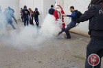 Israeli forces attack Santa Claus march with tear gas and rubber bullets to stop anti-occupation message on Christmas Eve 2016.