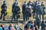 Police crack down on peaceful water protectors with rubber bullets and pepper spray (Red Warrior Camp)