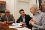 Julian Assange with Ecuador's Foreign Minister Guillaume Long, centre, and Spanish lawyer and former judge Baltasar Garzon at the Ecuadorean embassy (AFP/Getty)