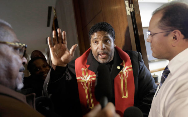 Rev. William Barber, center, argues his right to enter the House Speaker's office at the North Carolina General Assembly in Raleigh, N.C. AP / Gerry Broome