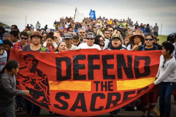 Native Americans march to a sacred burial ground site that was disturbed by bulldozers building the Dakota Access Pipeline. (Photo: Robyn Beck/AFP/Getty Images)