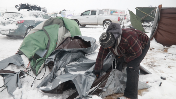 A tent collapses during a snow blizzard that hit the Standing Rock camp on Dec. 5, 2016. Task & Purpose photo
