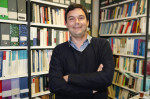 French economist and academic Thomas Piketty poses on May 12, 2014, in his book-lined office at the French School for Advanced Studies in the Social Sciences, in Paris. Photo courtesy of Reuters/Charles Platiau *Editors: This photo may only be republished with RNS-NASSER-OPED, originally transmitted on Nov. 22, 2016.