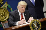 President Donald Trump signs Executive Orders in the Hall of Heroes at the Pentagon in Arlington, Virginia on Jan. 27. Olivier Douliery / EPA