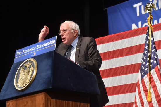 Sanders speaking at free tuition announcement in NY on January 3, 3017. Source: NY Governors office.